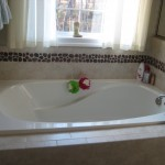 Tiled bath with garden tub.