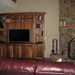 Custom media center and stone fireplace.